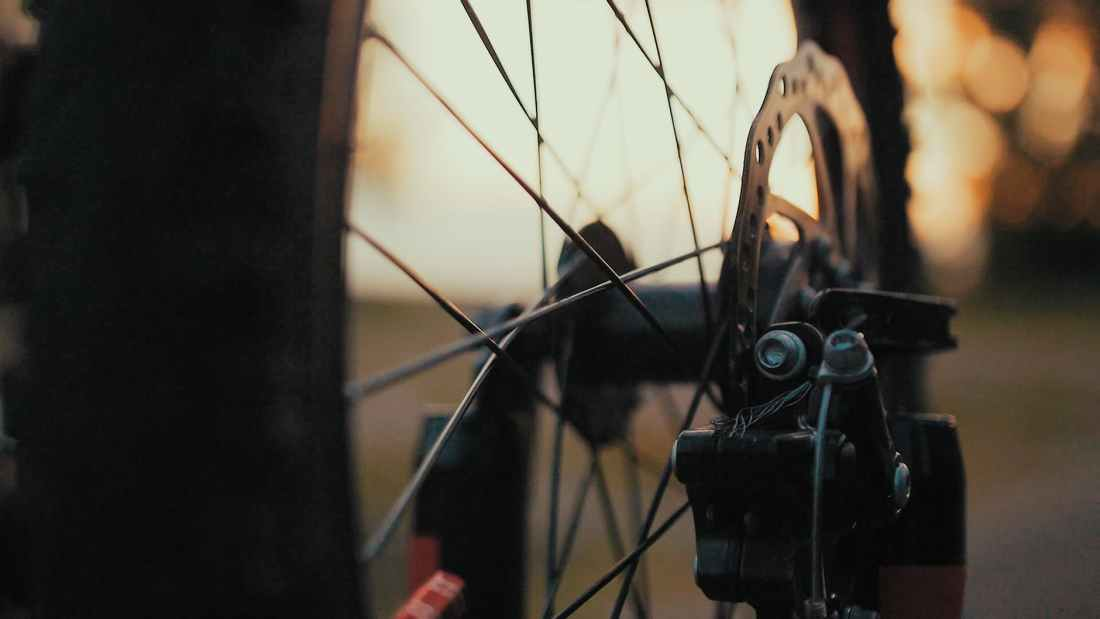 close up photo of black bicycle wheel